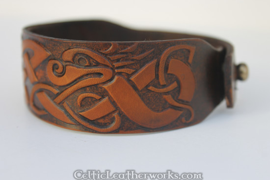 This is the Celtic Dragon Leather Cuff. This leather armband by Celtic Leatherworks fits wrist sizes 7 - 9 inches.