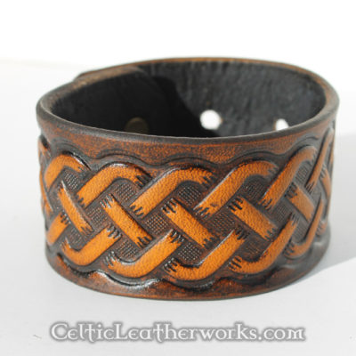This leather cuff features an embossed Celtic pointed knot design. It has been hand stained to give it a beautiful, rich look. It is made from hand selected full grain vegetable tanned leather. It is handmade in the USA. This leather armband by Celtic Leatherworks fits wrist sizes 7 - 9 inches.