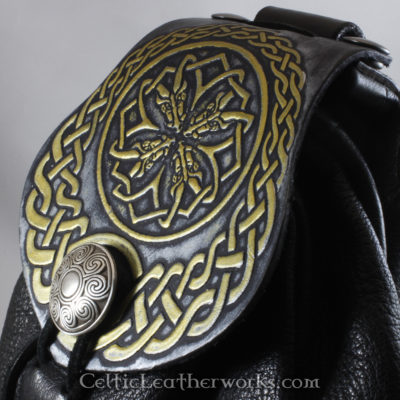 This is a custom colored Celtic Circle of Dragons Sporran. It is a Rob Roy style sporran with an Interchangeable Flap. The bag is made from black deer tanned leather. The flap is full grain vegetable tanned leather with a fearsome Celtic style dragon heads embossed into it.