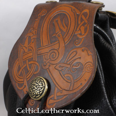 This is a custom colored Celtic Dragon Sporran. These sporrans have a unique Interchangeable Flap. The flap is full grain vegetable tanned leather with a beatiful Celtic Dragon into it.
