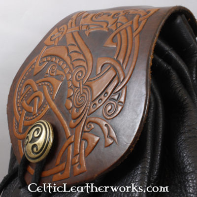 This is a custom colored Nordic Dragon Sporran. These sporrans have a unique Interchangeable Flap. The flap is full grain vegetable tanned leather with a powerful Nordic Dragon embossed into it.