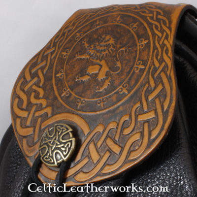 This is a custom colored Rampant Lion Sporran. These sporrans have a unique Interchangeable Flap. The flap is full grain vegetable tanned leather with a beatiful Rampant Lion into it.