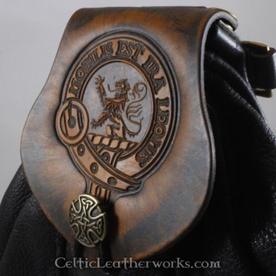 This is a custom colored Clan Stuart Of Bute Sporran. It is a Rob Roy style sporran with an Interchangeable Flap. The bag is made from black deer tanned leather. The flap is full grain vegetable tanned leather with the Stuart Of Bute clan crest embossed into it.
