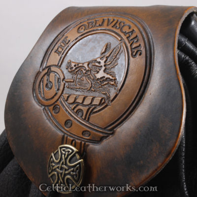"""This is the Clan Campbell Sporran. It is a Rob Roy style sporran with an Interchangeable Flap. The bag is made from black deer tanned leather. The flap is full grain vegetable tanned leather with the Campbell crest and motto """"Ne Obliviscaris"""" (Forget Not) embossed into it."""