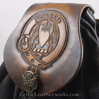 "This is the Clan Douglas Sporran. It is a Rob Roy style sporran with an Interchangeable Flap. The bag is made from black deer tanned leather. The flap is full grain vegetable tanned leather with the Maxwell crest and motto ""Foward"" embossed into it."