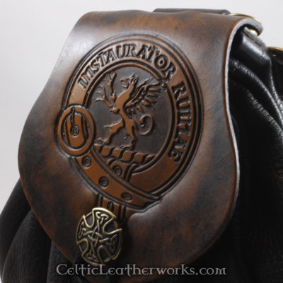 "This is the Clan Forsyth Sporran. It is a Rob Roy style sporran with an Interchangeable Flap. The bag is made from black deer tanned leather. The flap is full grain vegetable tanned leather with the Maxwell crest and motto ""Instaurator Ruinae""  (A Repairer of Ruin) embossed into it."