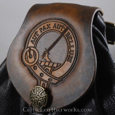 This is a custom colored Clan Gunn Sporran. It is a Rob Roy style sporran with an Interchangeable Flap. The bag is made from black deer tanned leather. The flap is full grain vegetable tanned leather with the Gunn clan crest embossed into it.