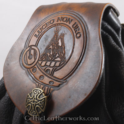 "This is the Clan MacKenzie Sporran. It is a Rob Roy style sporran with an Interchangeable Flap. The bag is made from black deer tanned leather. The flap is full grain vegetable tanned leather with the Maxwell crest and motto ""Luceo Non Uro""  (Shine Not Burn) embossed into it."