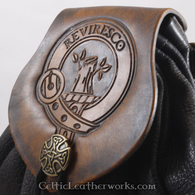 """This is Clan Maxwell Sporran. It is a Rob Roy style sporran with an Interchangeable Flap. The bag is made from black deer tanned leather. The flap is full grain vegetable tanned leather with the Maxwell crest and motto """"Reviresco""""  (I flourish Again) embossed into it."""