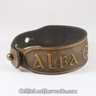 This is the Alba gu Brath leather cuff. Alba gu Brath is Scots Gaelic for Scotland Forever. Show your Scottish pride with this classic bracelet. It is a 3 sizes in 1 unisex bracelet. It has holes punched at 7, 8, and 9 inches to fit most size wrists.