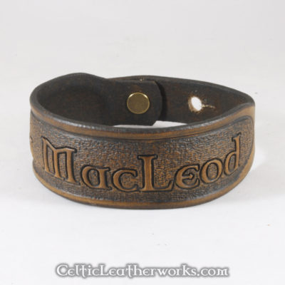 This is the Clan MacLeod leather cuff.  Show your Scottish pride with this classic bracelet. It is a 3 sizes in 1 unisex bracelet. It has holes punched at 7, 8, and 9 inches to fit most size wrists.