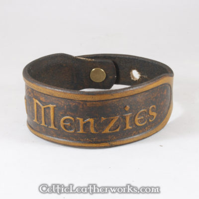 This is the Clan Menzies leather cuff.  Show your Scottish pride with this classic bracelet. It is a 3 sizes in 1 unisex bracelet. It has holes punched at 7, 8, and 9 inches to fit most size wrists.