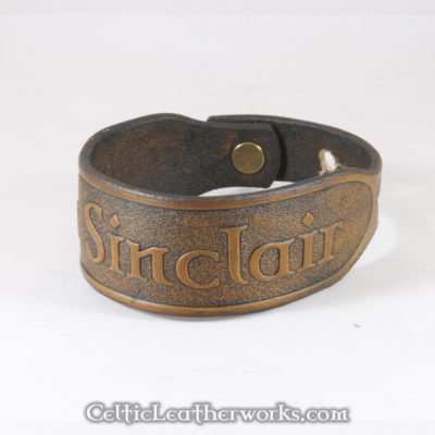 This is the Clan Sinclair leather cuff.  Show your Scottish pride with this classic bracelet. It is a 3 sizes in 1 unisex bracelet. It has holes punched at 7, 8, and 9 inches to fit most size wrists.