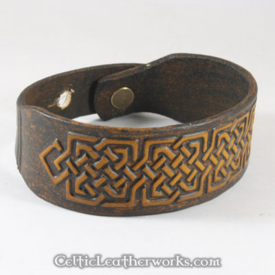 This is the Square Knot leather cuff.  Show your Celtic pride with this classic bracelet. It is a 3 sizes in 1 unisex bracelet. It has holes punched at 7, 8, and 9 inches to fit most size wrists.
