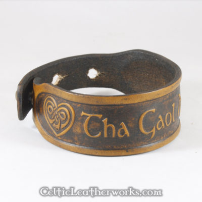 This is the Tha Gaol Agam Ort leather cuff. Tha Gaol Agam Ort is Scots Gaelic for I Love You. Show your Scottish pride with this classic bracelet. It is a 3 sizes in 1 unisex bracelet. It has holes punched at 7, 8, and 9 inches to fit most size wrists.