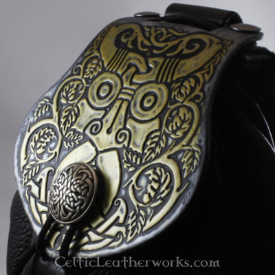 This is a custom colored Green Man Sporran. It is a Rob Roy style sporran with an Interchangeable Flap. The bag is made from black deer tanned leather. The flap is full grain vegetable tanned leather with an awesome Green Man face embossed into it.