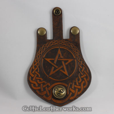 This is a custom colored Pentacle Sporran. It is a Rob Roy style sporran with an Interchangeable Flap. The bag is made from black deer tanned leather. The flap is full grain vegetable tanned leather with an ancient Pentacle embossed into it.