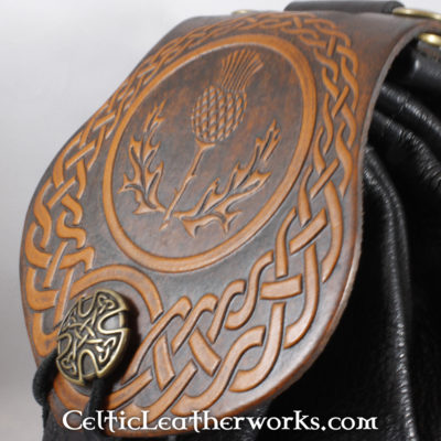 This is a custom colored AScottish Thistle Sporran. These sporrans have a unique Interchangeable Flap. The flap is full grain vegetable tanned leather with a beautiful Scottish Thistle embossed into it.