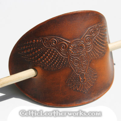 These are leather barrettes with embossed Celtic images. They are oval stick barrettes measuring 3 inches between the holes. Made from hand selected top grain vegetable tanned leather.