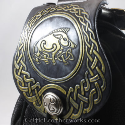 This is a custom colored Celtic Boar Sporran. It is a Rob Roy style sporran with an Interchangeable Flap. The bag is made from black deer tanned leather. The flap is full grain vegetable tanned leather with a firece Celtic Boar embossed into it.